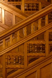 A detail of the intricate woodwork on the staircase of Hank and Ann Triplett's home in Old Louisville. March 18, 2019.