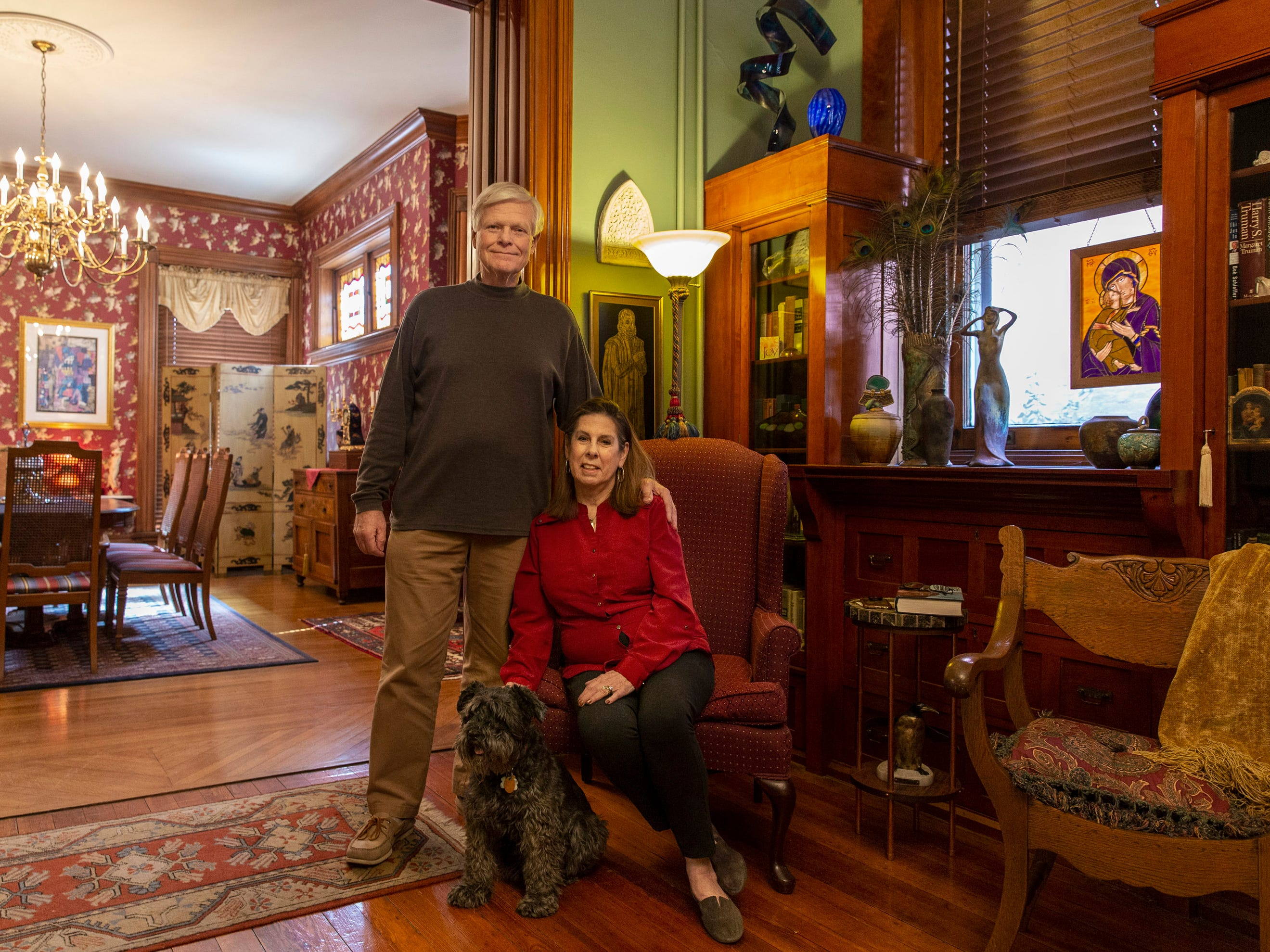 Hank and Ann Triplett's and their dog, Louie, in the living room of their home in Old Louisville. March 18, 2019.