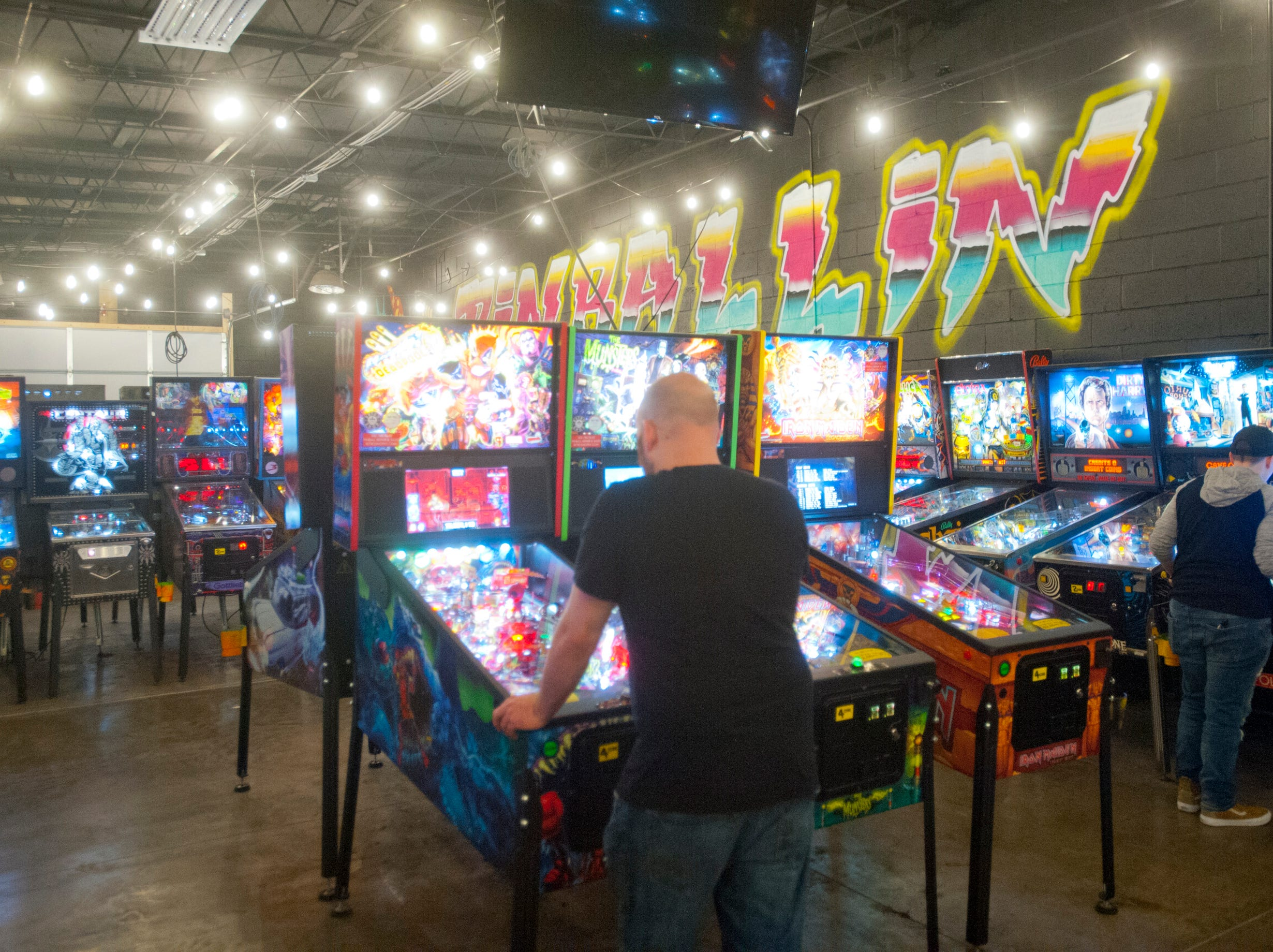 A patron plays in one of the arcade rooms of the eatery.14 March 2019