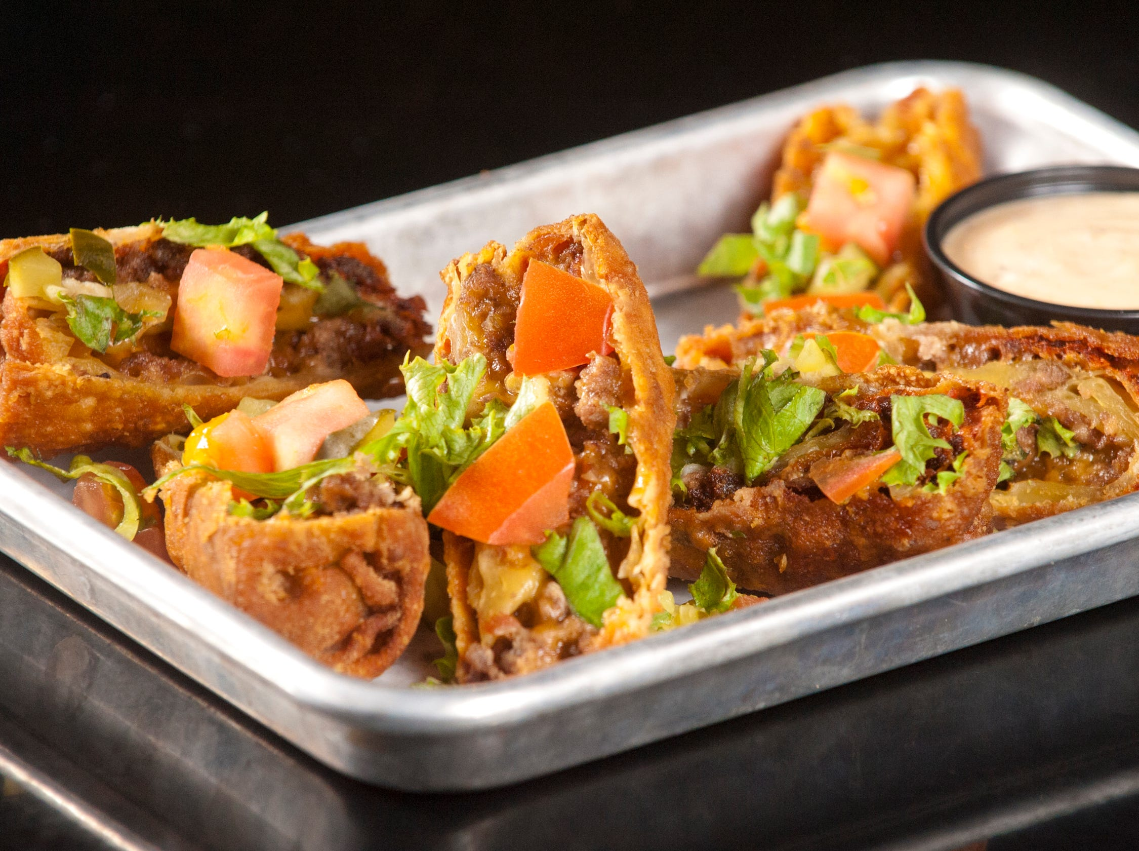 The Recbar's Burgertime Rolls start with wonton wrappers to which a combination of ground beef, bacon bits and cheddar cheese is added. The wontons are then rolled and deep fried, then topped with shredded lettuce, tomato and pickles.14 March 2019