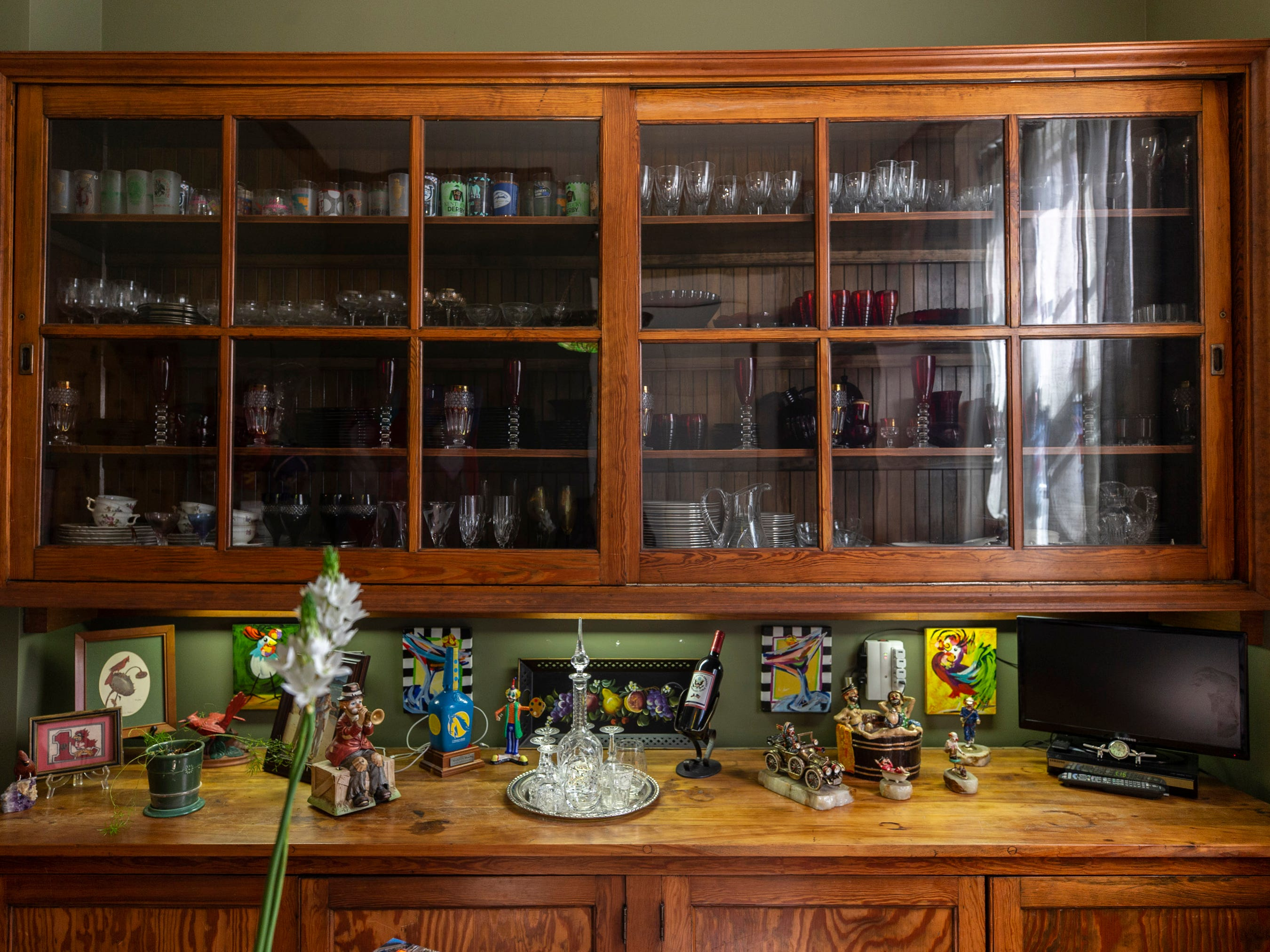 A cabinet in the original butler's pantry in Hank and Ann Triplett's home in Old Louisville. March 18, 2019.