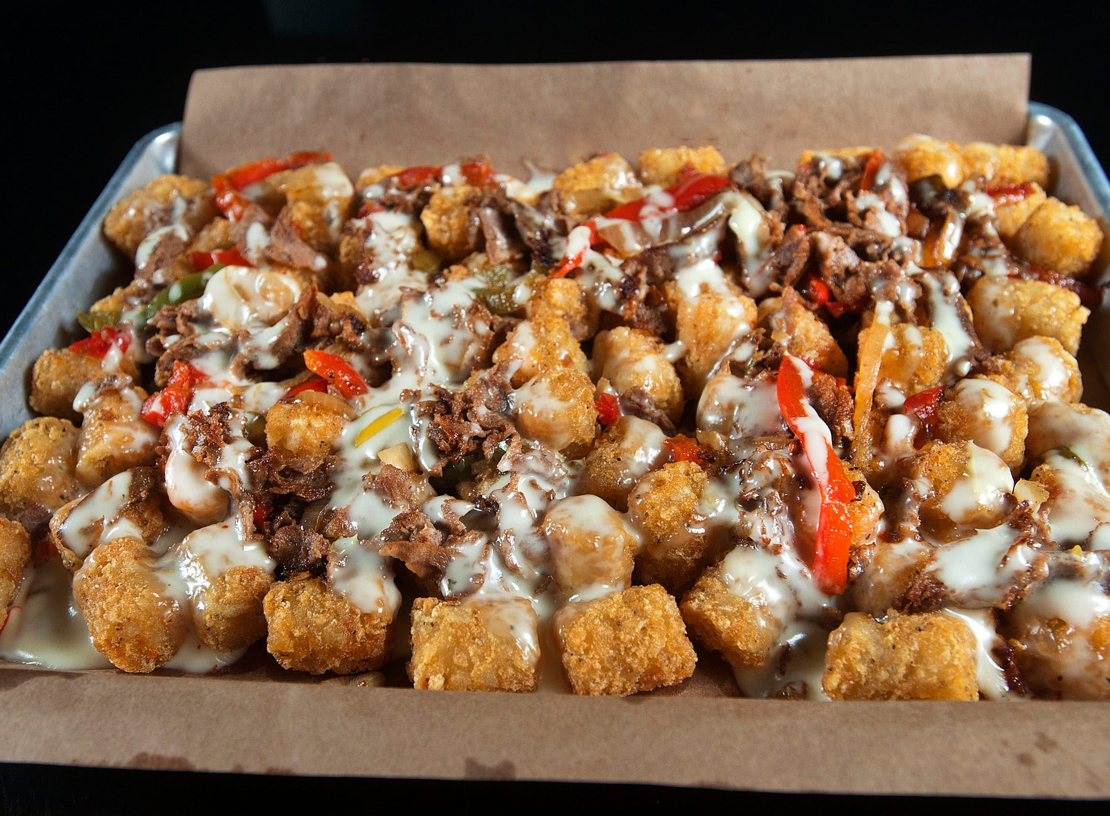 The Recbar's Always Sunny Totchos starts with tater tots that are deep fried then covered with nacho ingredients queso cheese, Philly steak pieces, and a mix of sauteed onion, green and red bell pepper bits.14 March 2019