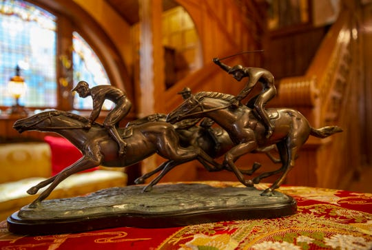 Horses and jockeys in motion in a bronze sculpture in Hank and Ann Triplett's home in Old Louisville. March 18, 2019.