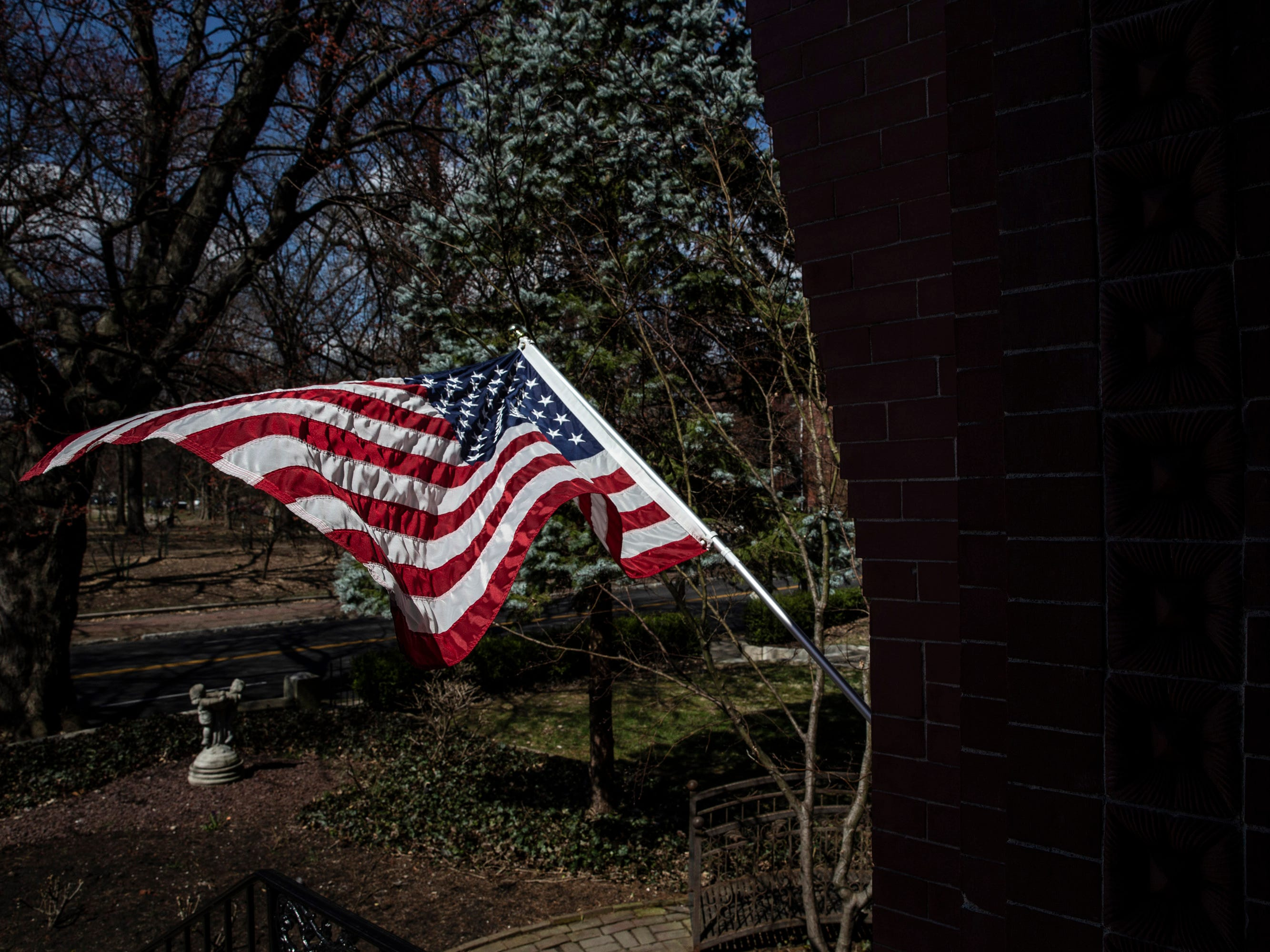 An American flag flies at the entrance of Hank and Ann Triplett's home. March 18, 2019.