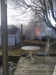 Neighbor Tim Lawson said he awakened Tuesday to see fire coming out of a window at 304 W. Mansfield St.