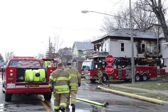 Firefighters from the Bucyrus Fire Department prepare to leave the scene of a fire at 304 W. Mansfield St. on Tuesday, March 19, 2019.