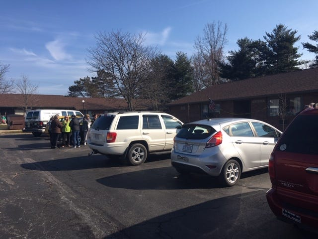 A crowd of friends and neighbors at Morchester Villa Tuesday morning gather outside after learning a 90-year-old man was a stabbing victim. Mansfield police are on the scene on Middle-Bellville Road.