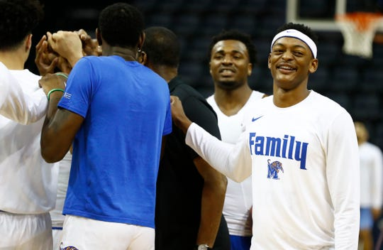 Memphis players, including Memphis Tigers forward Kyvon Davenport (0), right, huddle before their first round NIT game against San Dieg at the FedExForum, Tuesday, March 19, 2019.