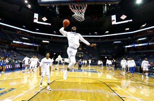 Memphis Tigers guard Raynere Thornton (4) warms up before the NIT game against San Diego at the FedExForum, Tuesday, March 19, 2019.