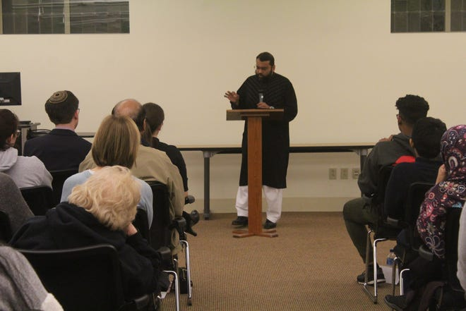 Yasir Qadhi, a professor at Rhodes College, speaks to a group of 250 or more people during a vigil on March 18, 2018, following a New Zealand Mosque shooting.