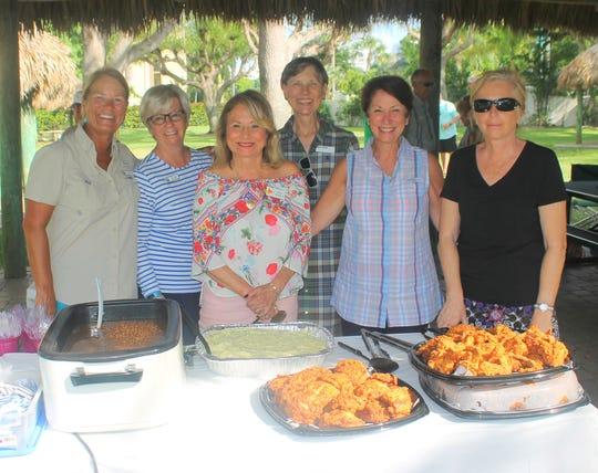 Serving the chicken dinner are Chris Laimbeer,  Nancy Roble,  Carol Schwalje,  Karna Rinke,  Ann Marchetti,  Anna Hutchings