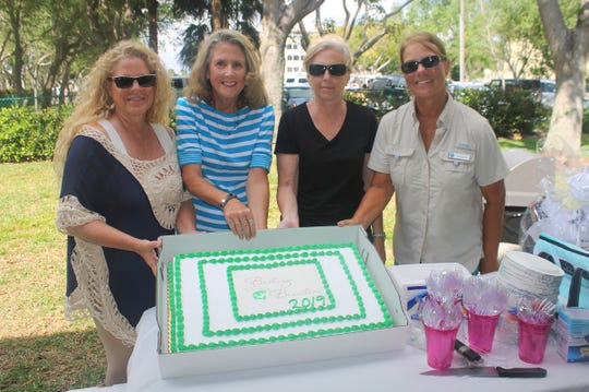 Serving the Baiting Beauties cake are Patricia Burdette, Betsy Wohltman, Anna Hutchings and Chris Laimbeer.