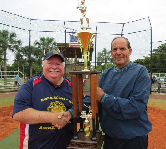 Jim Conway, Manager for the American Legion Post, is presented the Gulf Coast dvisional championship trophy from League Commissioner Bill Shurina.