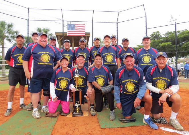 American Legion Post are the 2019 Gulf Coast divisional champions. From left, back: Al Bozzo, Mike Gallagher, Doug Patton (coach), Darryl Judson (coach), Tony Brock, Bill Diamond, Dan Callahan, Jack Patterson (coach), Charles Pineno and Jerry Lenhoff; front: Manager Jim Conway, Trish Conway (statistician), Leon Schmitt, Paul Burnett, Tom Patterson and Dick DeAnna.