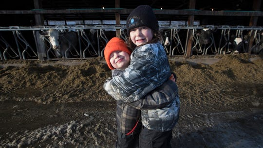 Seven-year-old Starr Thewis hugs her 4-year-old brother Skyler.