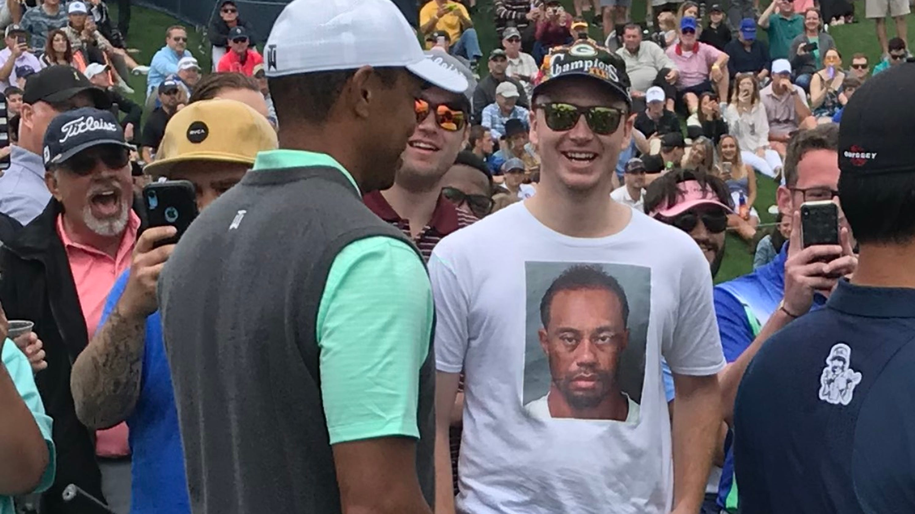 c9e6f8462fc89 A New Berlin Eisenhower graduate drew a laugh from Tiger Woods for wearing  the golfer s DUI arrest mugshot on a shirt