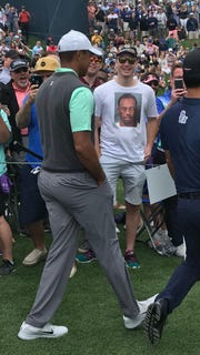 Thomas Wesling of New Berlin gets a laugh out of Tiger Woods during the PGA Players Championship in Florida on March 16, 2019.