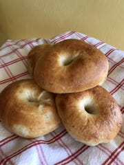After a minute in boiling water, the bagels are baked at a high temperature until a deep golden brown.