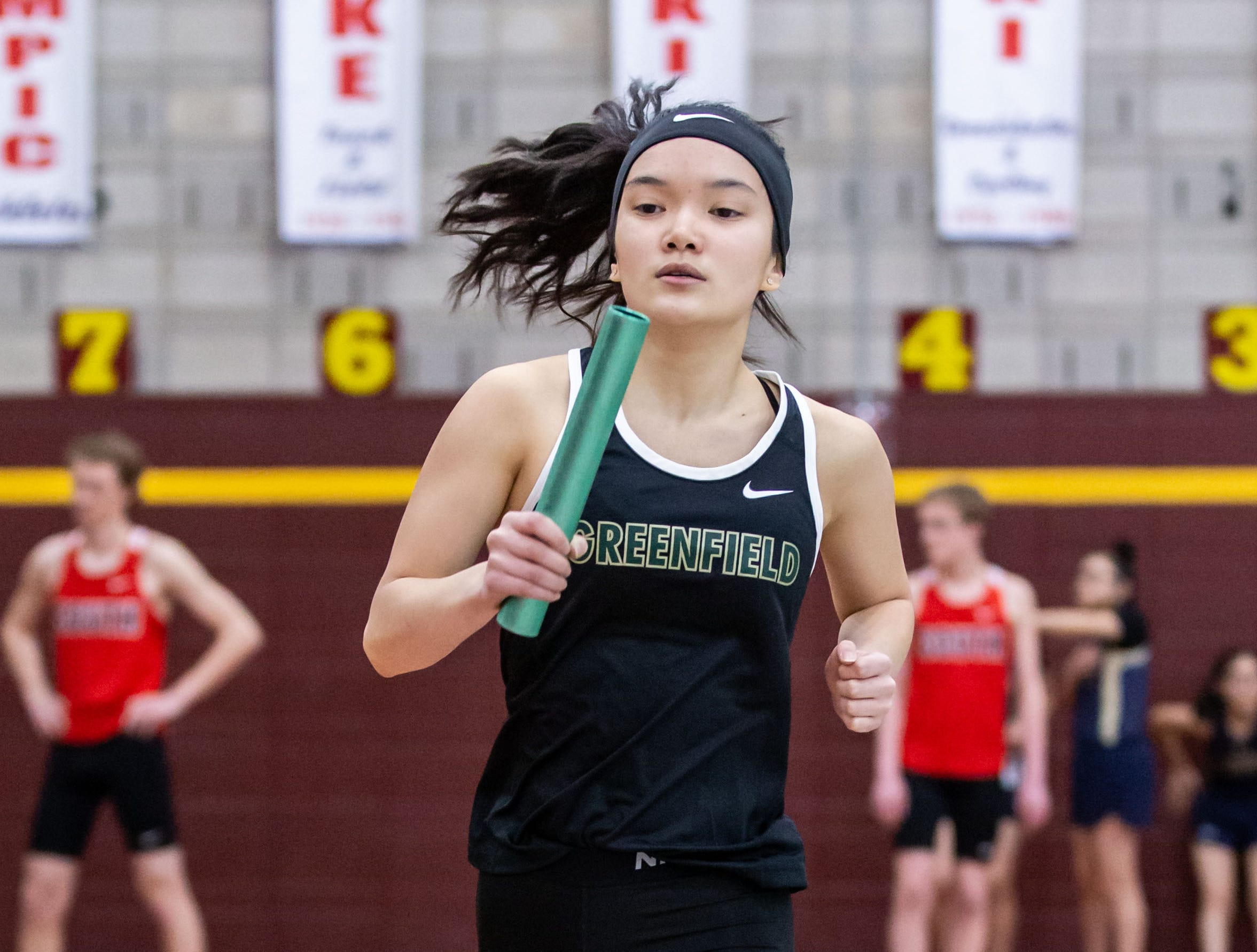 Greenfield's Lilly Ho competes in the distance medley relay at the Reinhard Bulldog Relays hosted by West Allis Central on Friday, March 15, 2019.