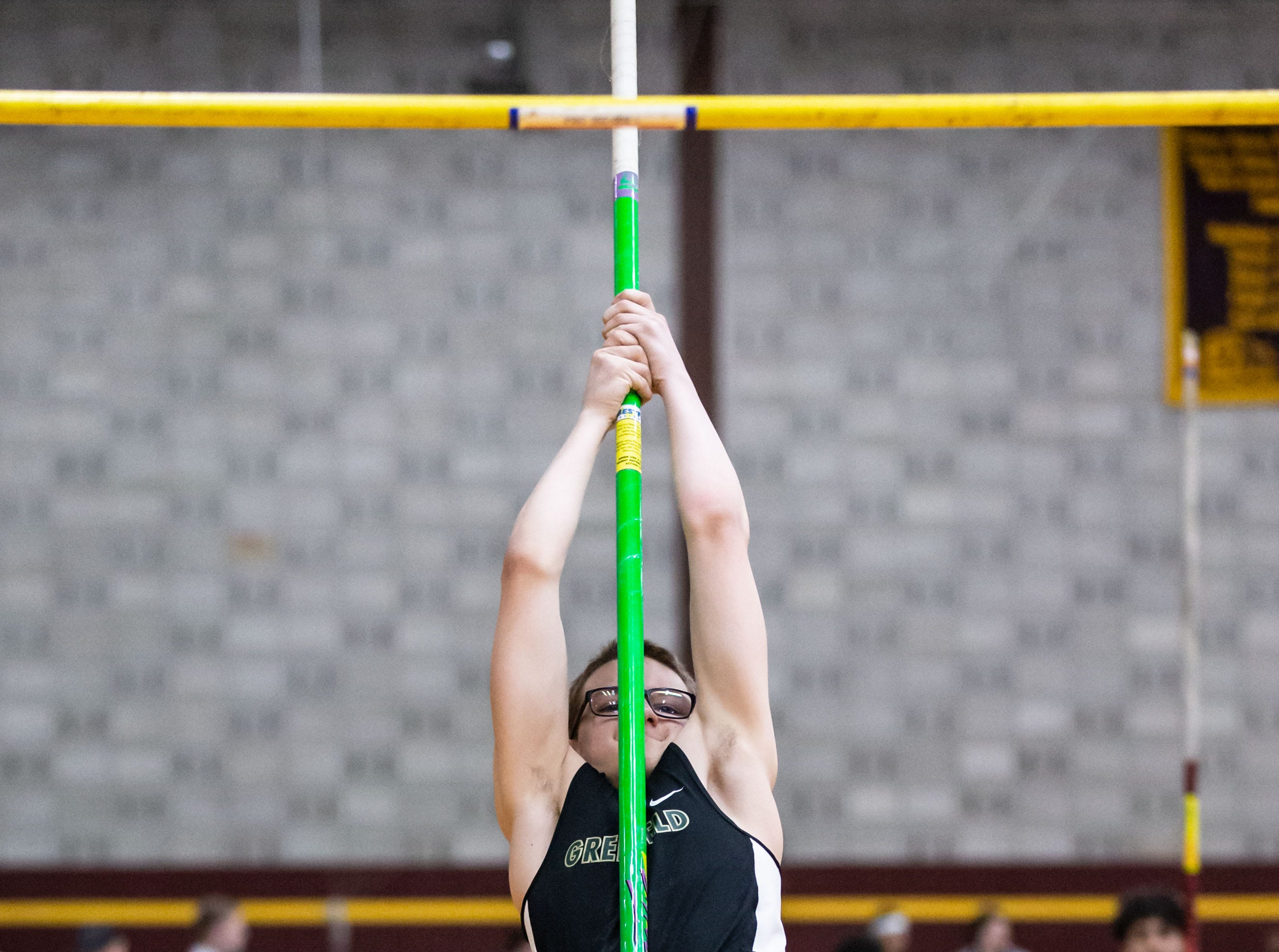 Greenfield's Zackery Mrnik competes on the pole vault at the Reinhard Bulldog Relays hosted by West Allis Central on Friday, March 15, 2019.