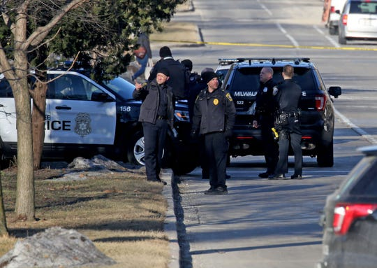 Police investigate the scene at East Kenwood Boulevard on the University of Wisconsin-Milwaukee campus Tuesday where UWM police officers shot a man at the Fine Arts Complex.