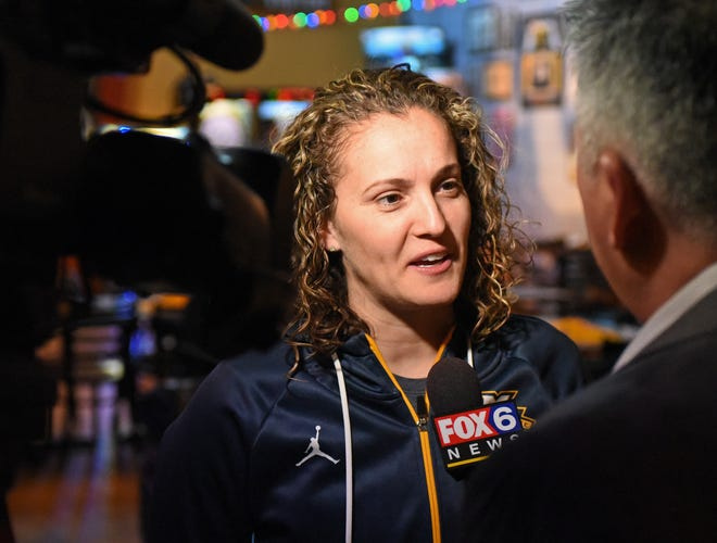 Marquette  coach Carolyn Kieger does a television interview after the NCAA women's tournament selection show Monday.