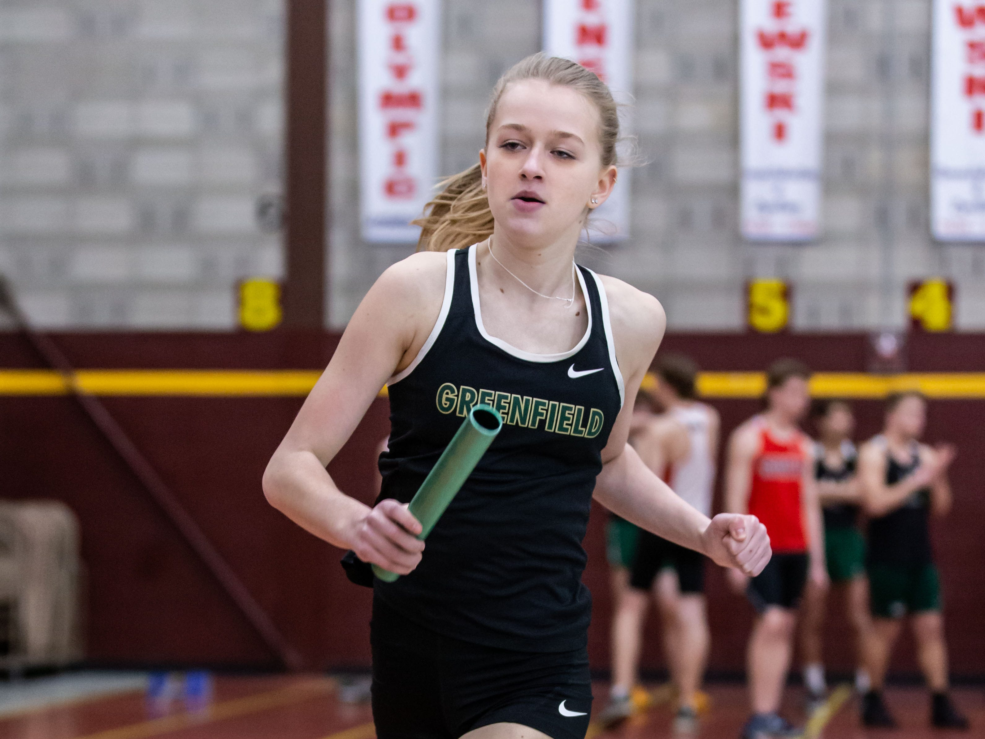 Greenfield's Megan Slatty competes in the distance medley relay at the Reinhard Bulldog Relays hosted by West Allis Central on Friday, March 15, 2019.