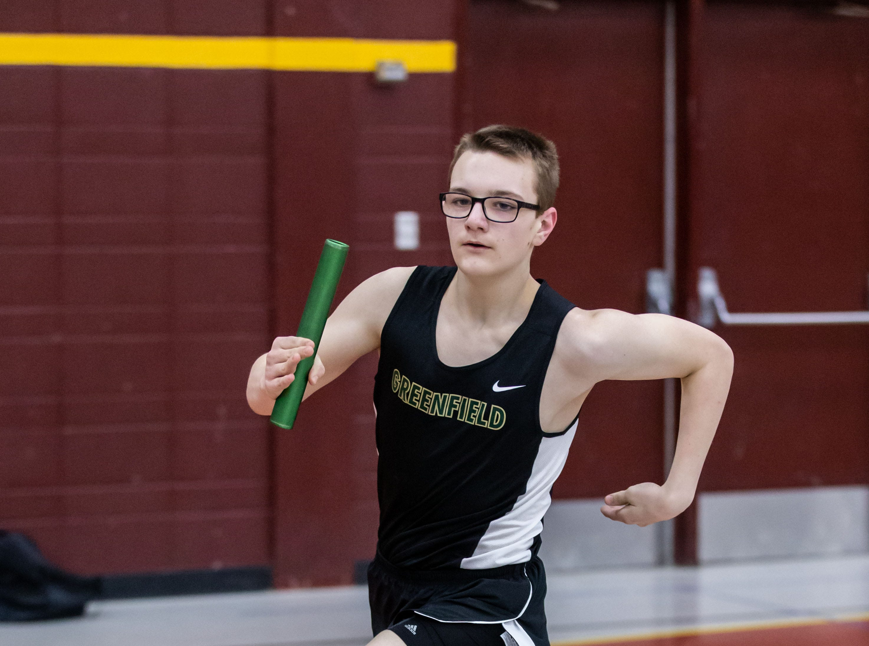 Greenfield's Zackery Mrnik competes in the distance medley relay at the Reinhard Bulldog Relays hosted by West Allis Central on Friday, March 15, 2019.