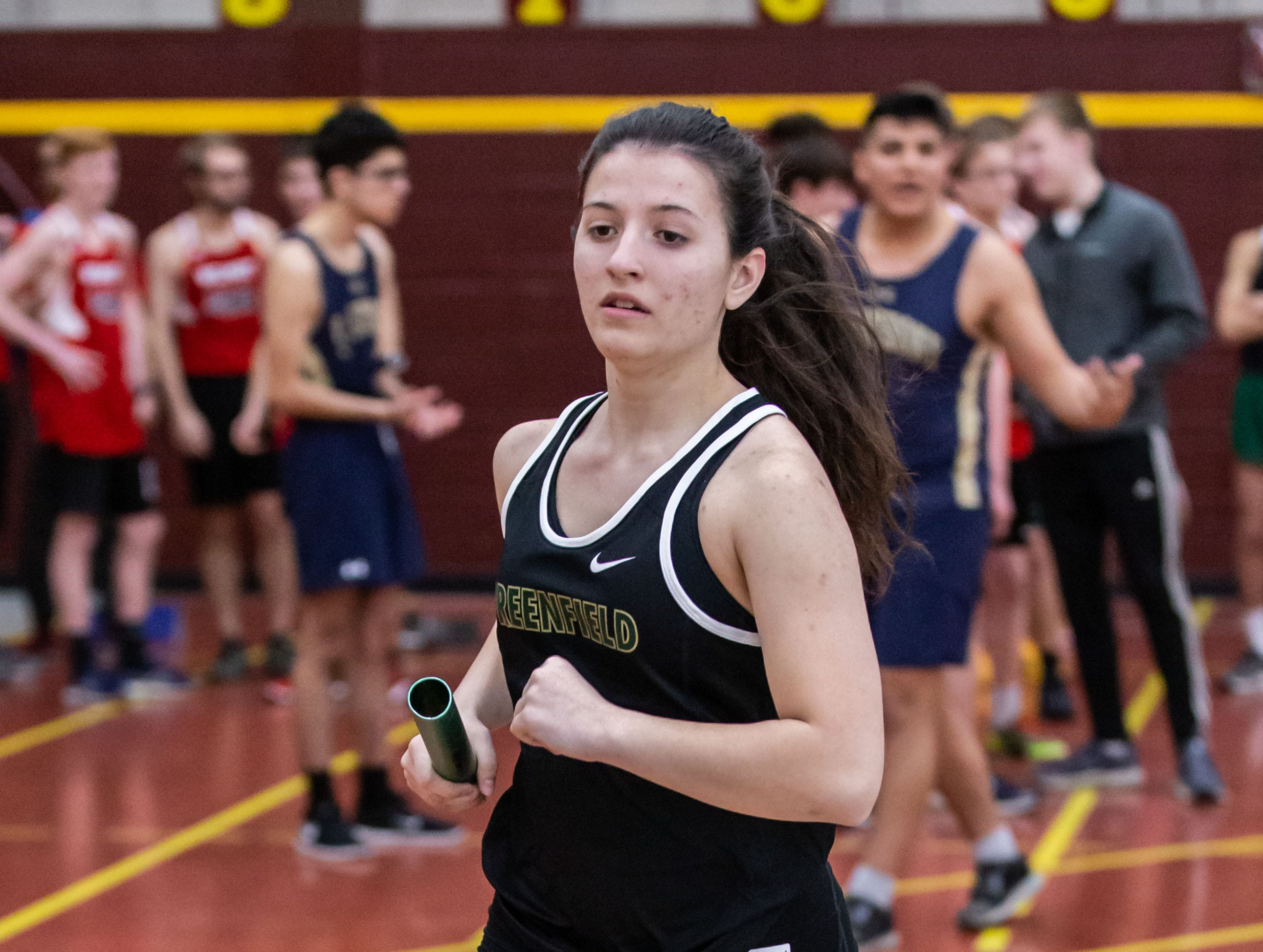 Greenfield's Julianna Schmidt competes in the distance medley relay at the Reinhard Bulldog Relays hosted by West Allis Central on Friday, March 15, 2019.