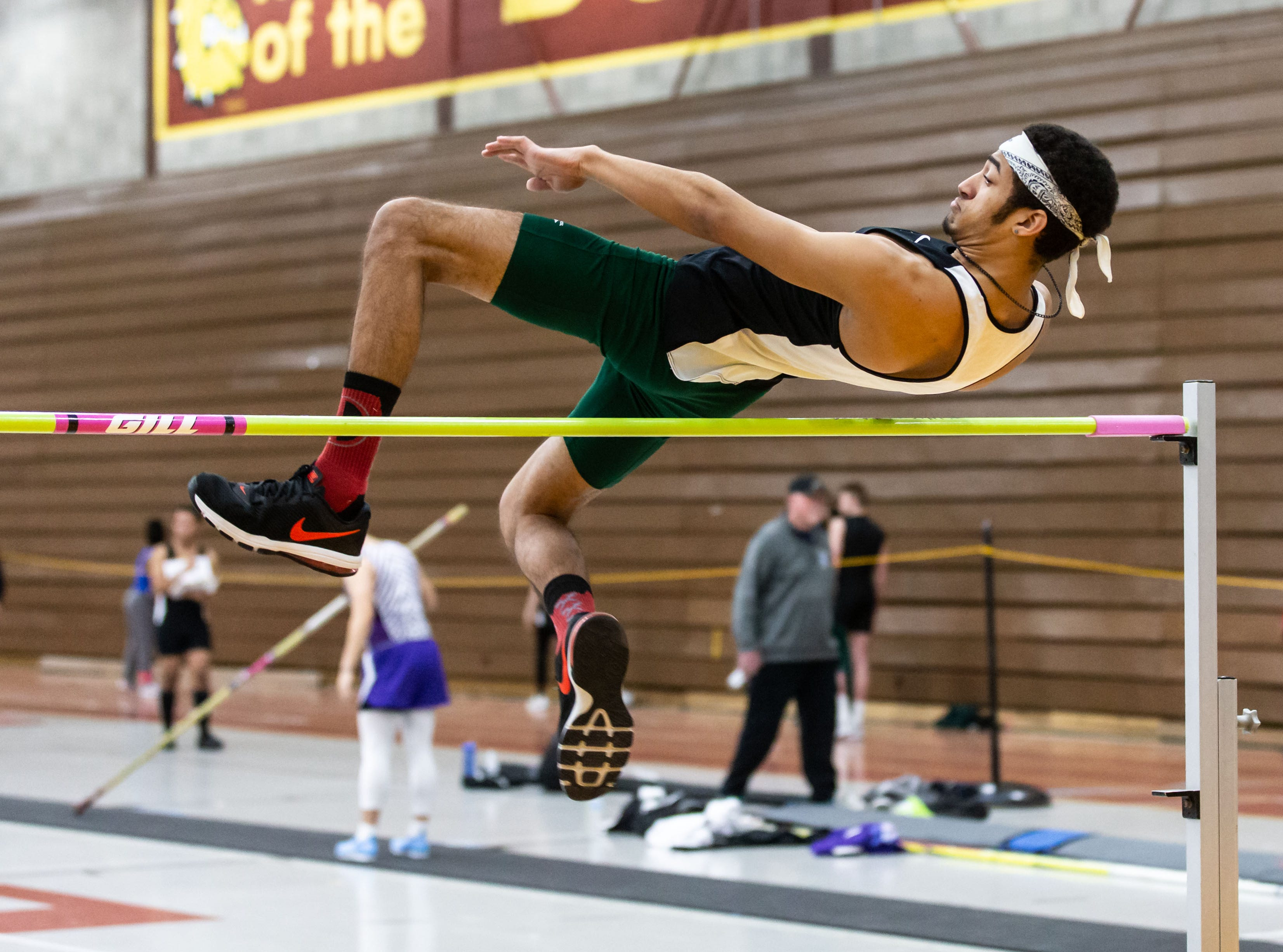 West Allis Nathan Hale's Darius Clark competes on the high jump at the Reinhard Bulldog Relays hosted by West Allis Central on Friday, March 15, 2019.
