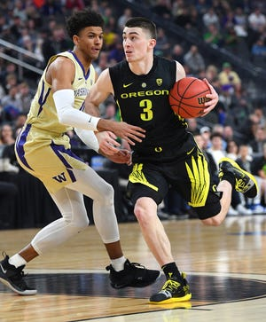 Oregon guard Payton Pritchard drives against against Washington guard Matisse Thybulle during the  Pac-12 tournament final.