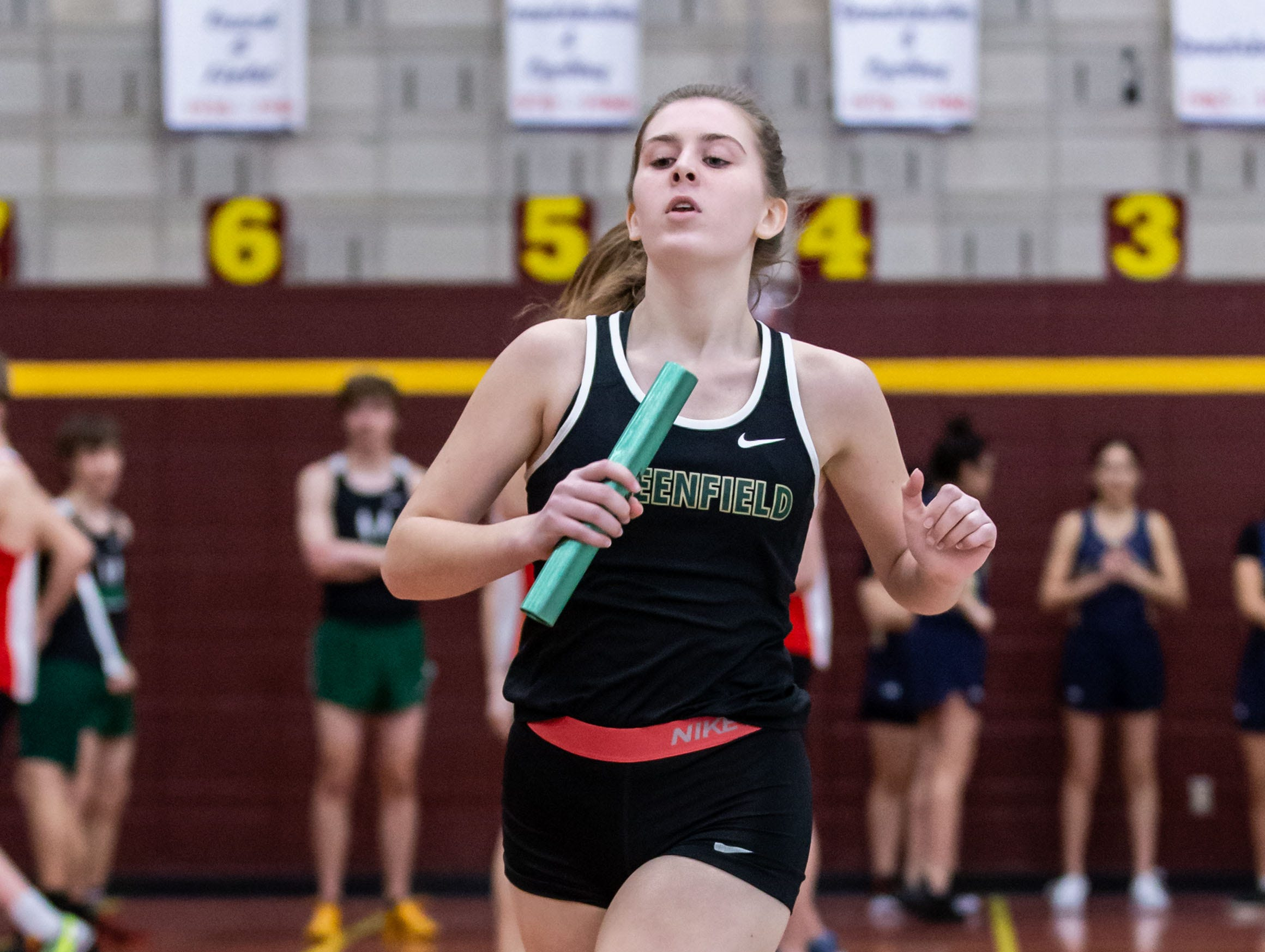 Greenfield's Emily Grill competes in the distance medley relay at the Reinhard Bulldog Relays hosted by West Allis Central on Friday, March 15, 2019.