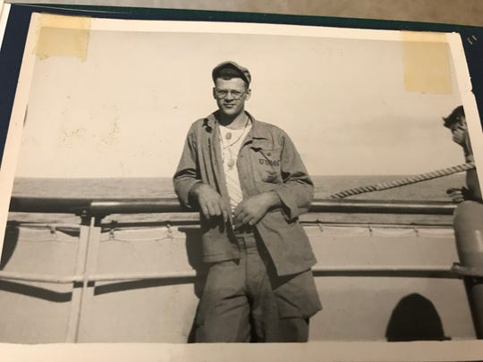 """Jack Hamilton on board a ship taking him to the Korean War in 1950. The 87-year-old Oconomowoc man is traveling on a Stars and Stripes Honor Flight with Hampton Sides, the author of a book on the Korean War, """"On Desperate Ground,"""" as his volunteer guardian."""