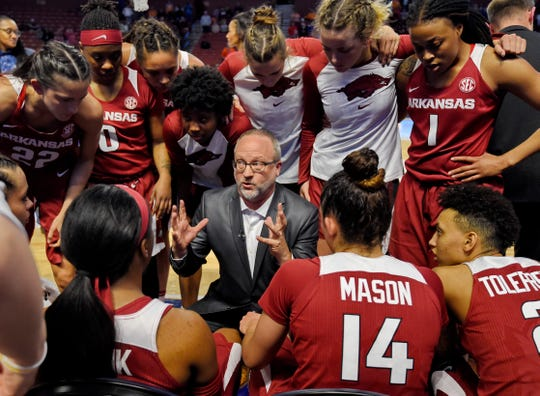 Arkansas head coach Mike Neighbors gives instructions during the second half of a game against Texas A&M in the Southeastern Conference women's tournament in Greenville, S.C.
