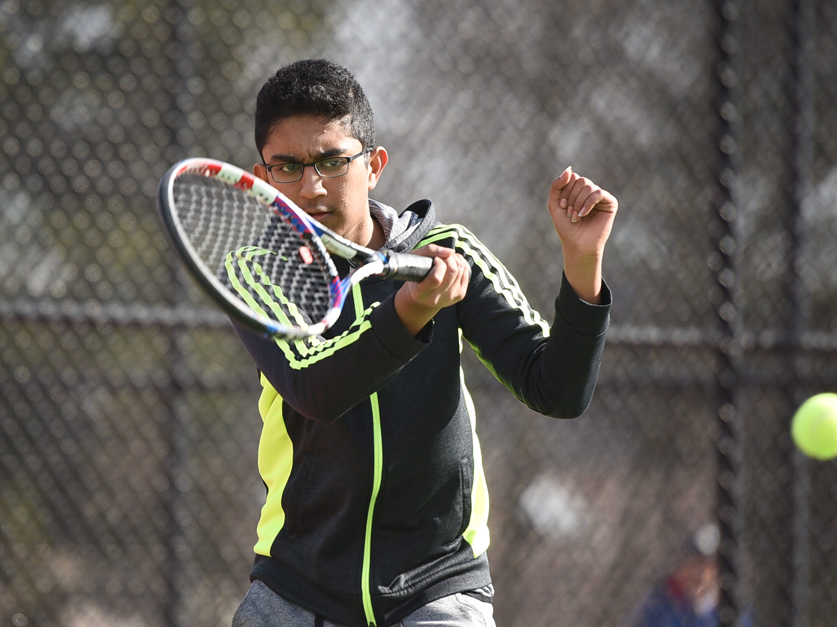Morris Hills boys tennis player Srikanth Dhamodharan (grade 10) of Montville plays during a practice, photographed at Morris Hills High School in Rockaway on 03/19/19. This is for the season preview on team diversity.