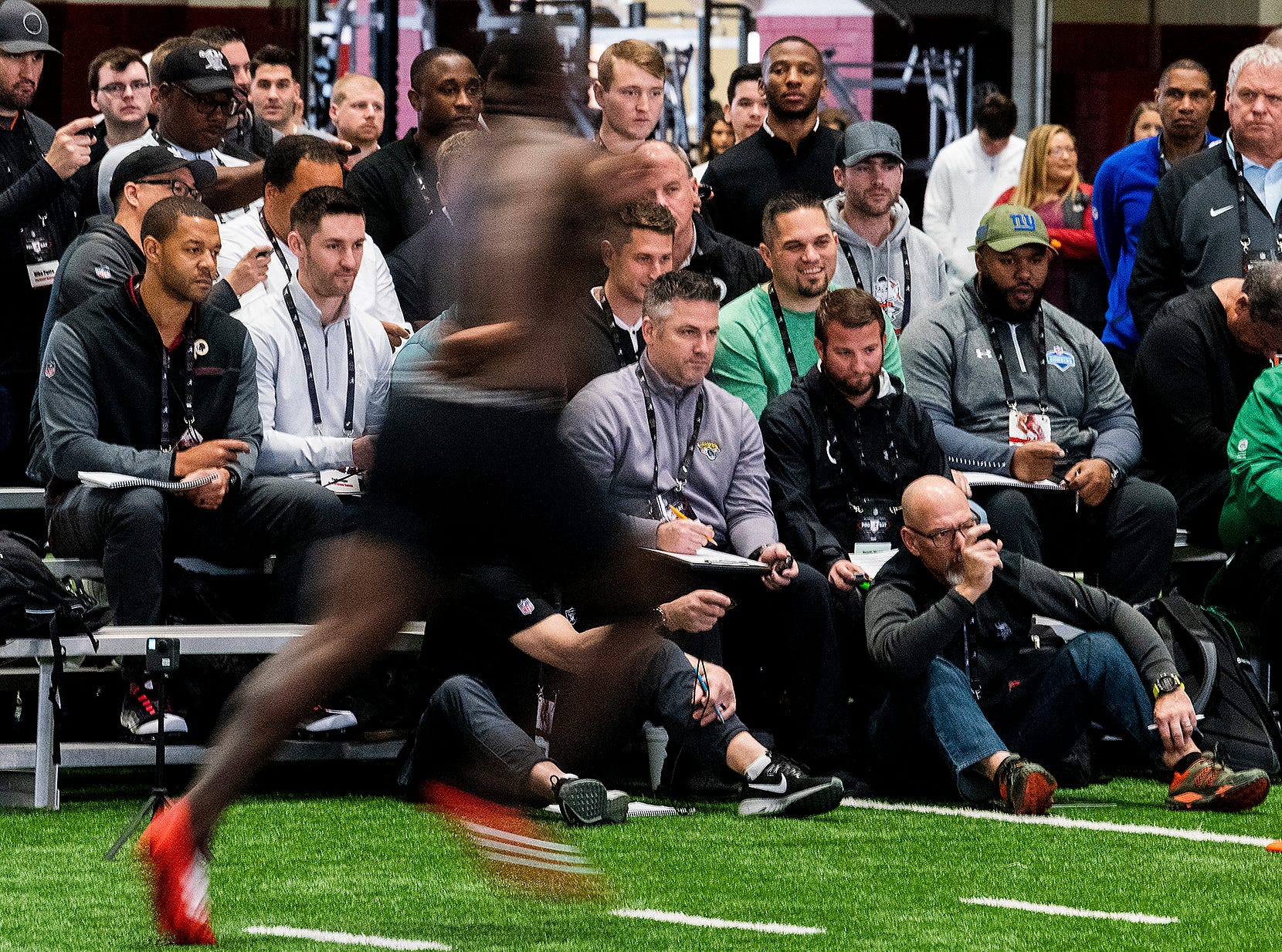 NFL scouts time players as they run the 40 during Pro Day on the University of Alabama campus in Tuscaloosa, Ala., on Tuesday March 19, 2019.