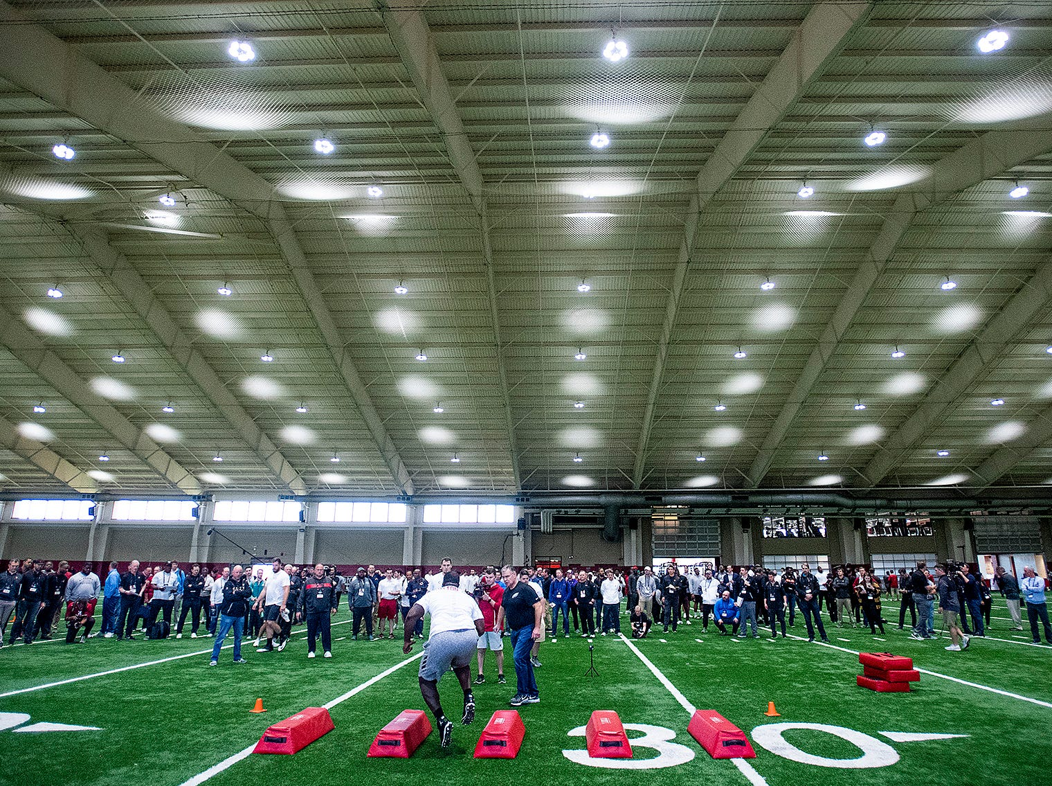 NFL scouts watch workouts during Pro Day on the University of Alabama campus in Tuscaloosa, Ala., on Tuesday March 19, 2019.