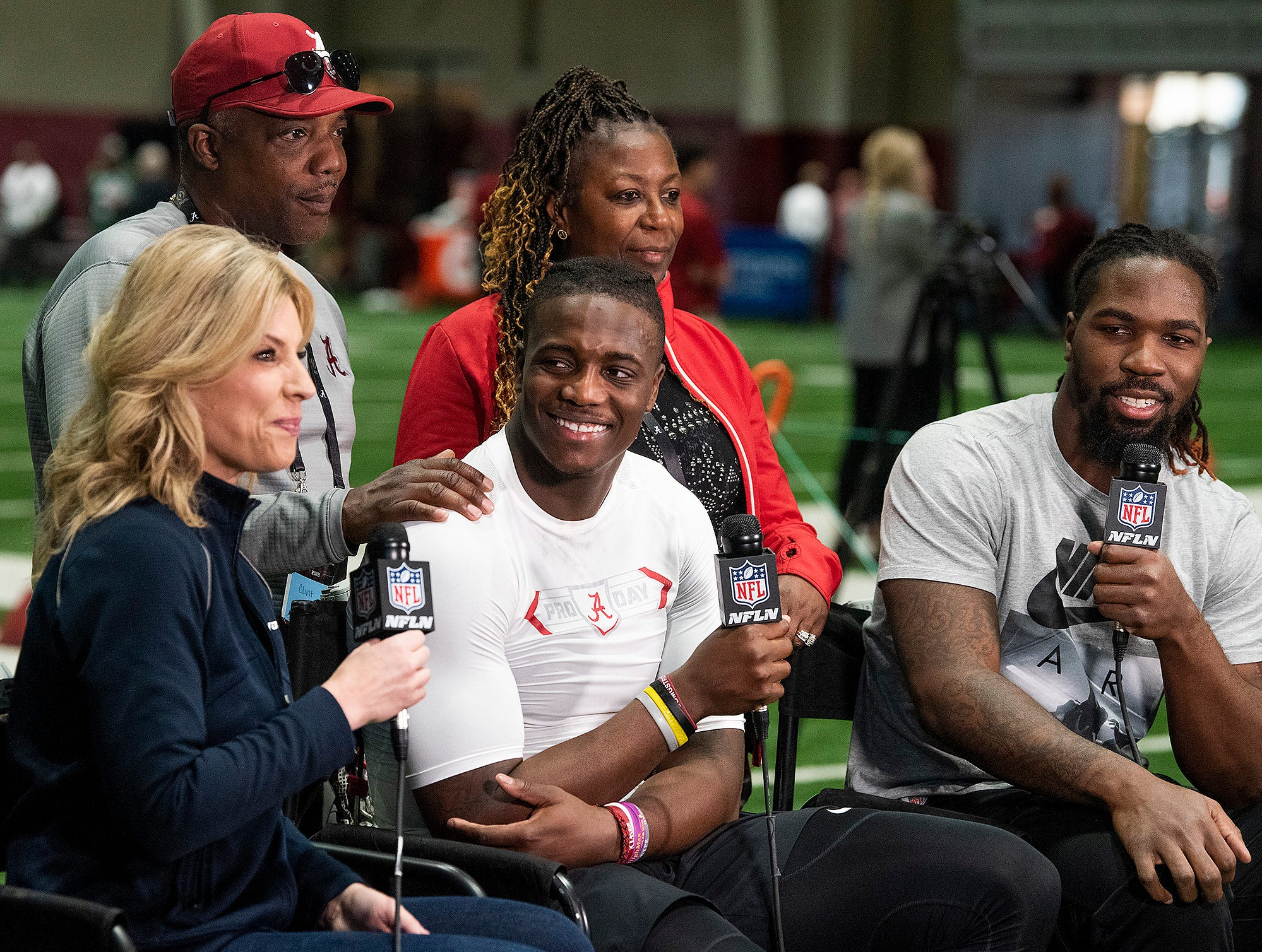 Alabama linebacker Jamey Mosley, center and his brother CJ Mosely are interviewed with their family during Pro Day on the University of Alabama campus in Tuscaloosa, Ala., on Tuesday March 19, 2019.
