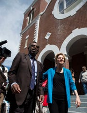 Pastor Leodis Strong walks with Sen. Elizabeth Warren outside Brown Chapel AME Church in Selma, Ala., on Tuesday, March 19, 2019.