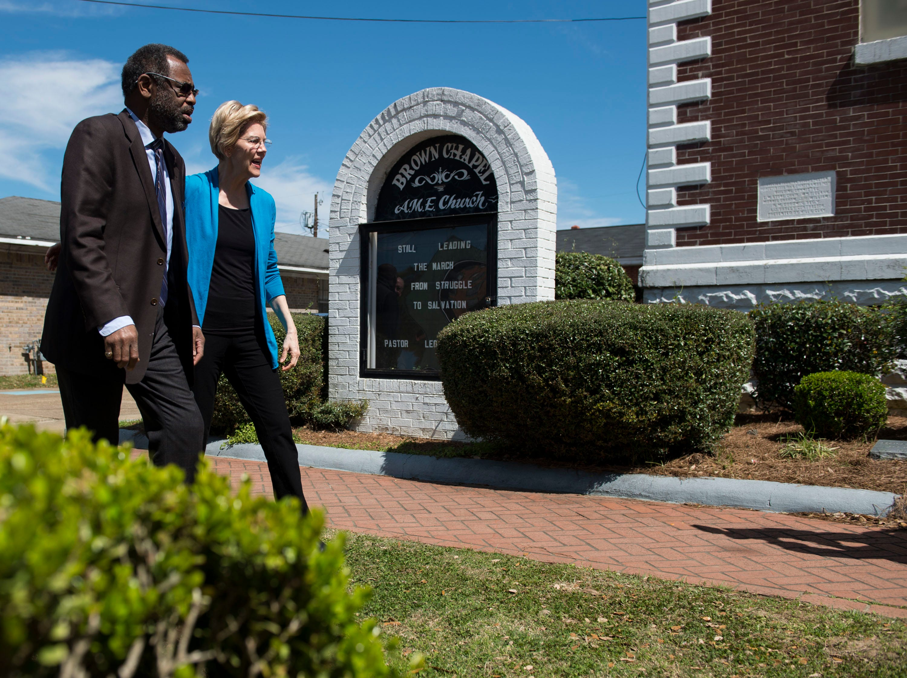 Pastor Leodis Strong walks with Sen. Elizabeth Warren into Brown Chapel AME Church in Selma, Ala., on Tuesday, March 19, 2019.