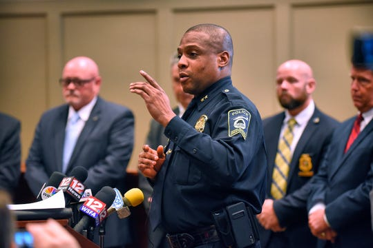 Ozark (Ala.) Police Chief Marlos Walker comments during a press conference Monday, March 18, 2019 announcing the arrest of Coley McCraney of nearby Dothan for the 1999 slayings of Dothan teens J.B. Beasley and Tracie Hawlett. McCraney was arrested Friday and is held in the Dale County Jail with no bond.  (Jay Hare/Dothan Eagle via AP)
