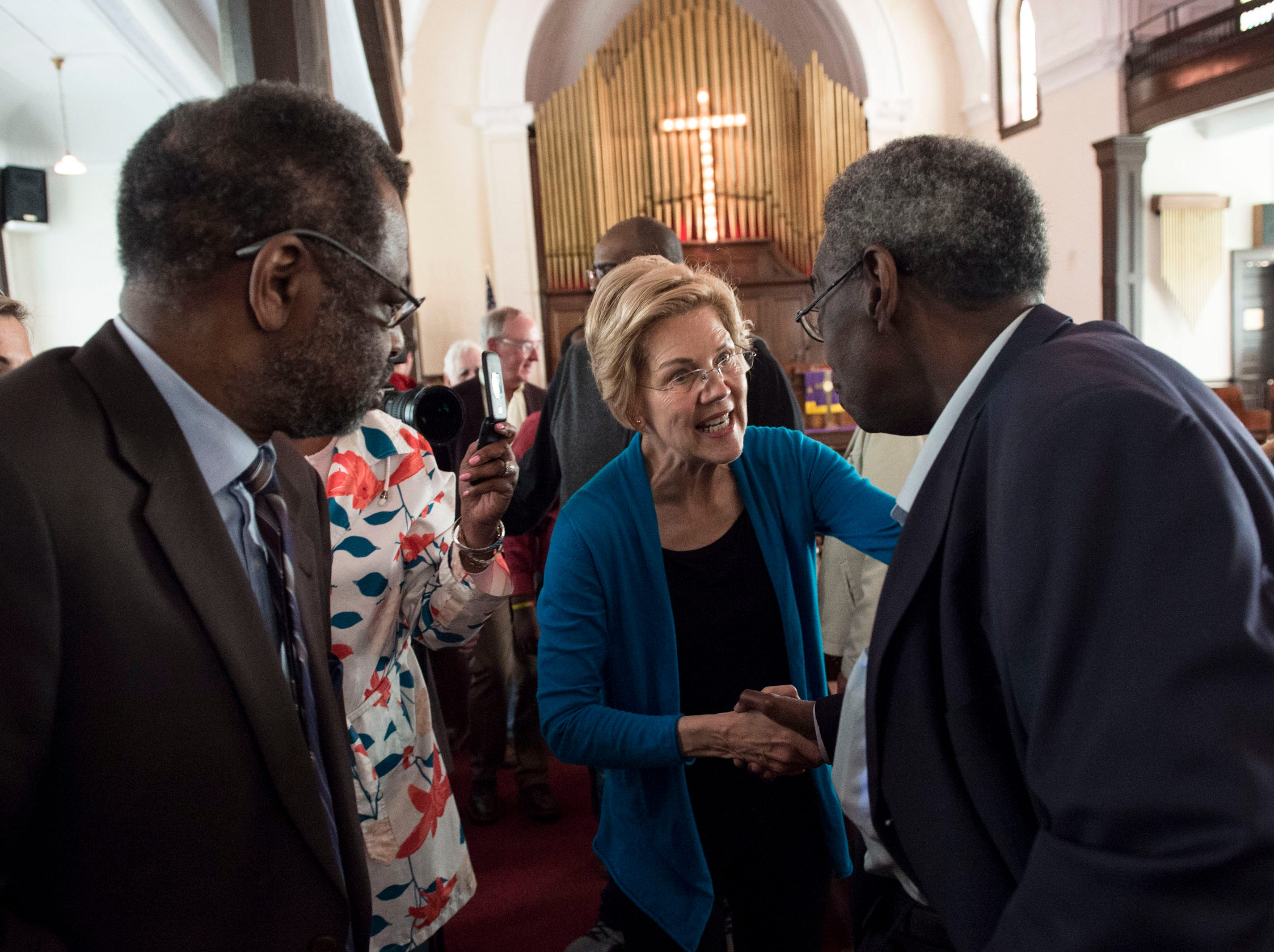 Sen. Elizabeth Warren shakes hands with Alabama State Sen. Henry Sanders at Brown Chapel AME Church in Selma, Ala., on Tuesday, March 19, 2019.