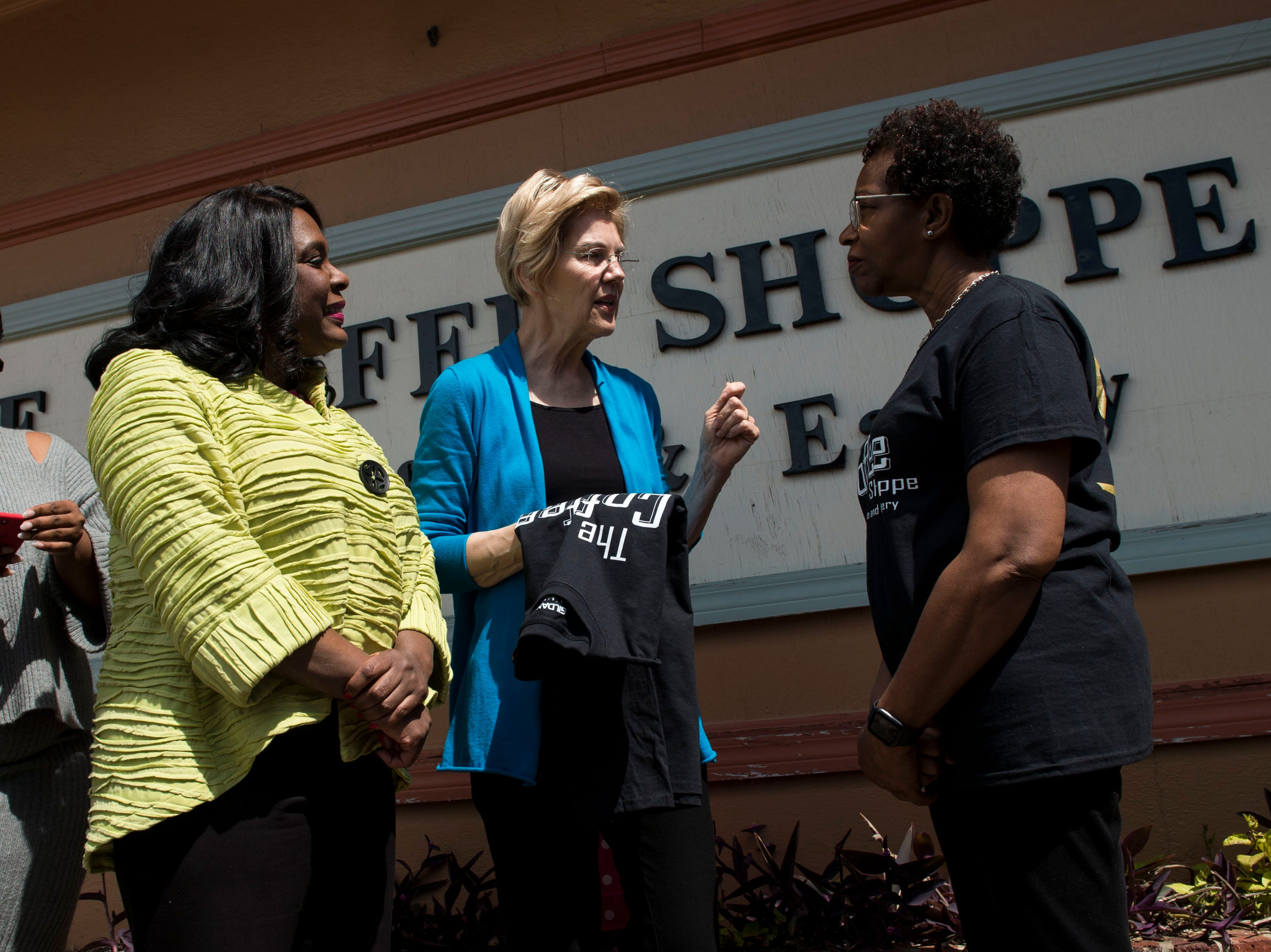 Rep Terri Sewell, left, and Sen. Elizabeth Warren talk with the owner of the Coffee Shoppe Jackie Smith in Selma, Ala., on Tuesday, March 19, 2019.
