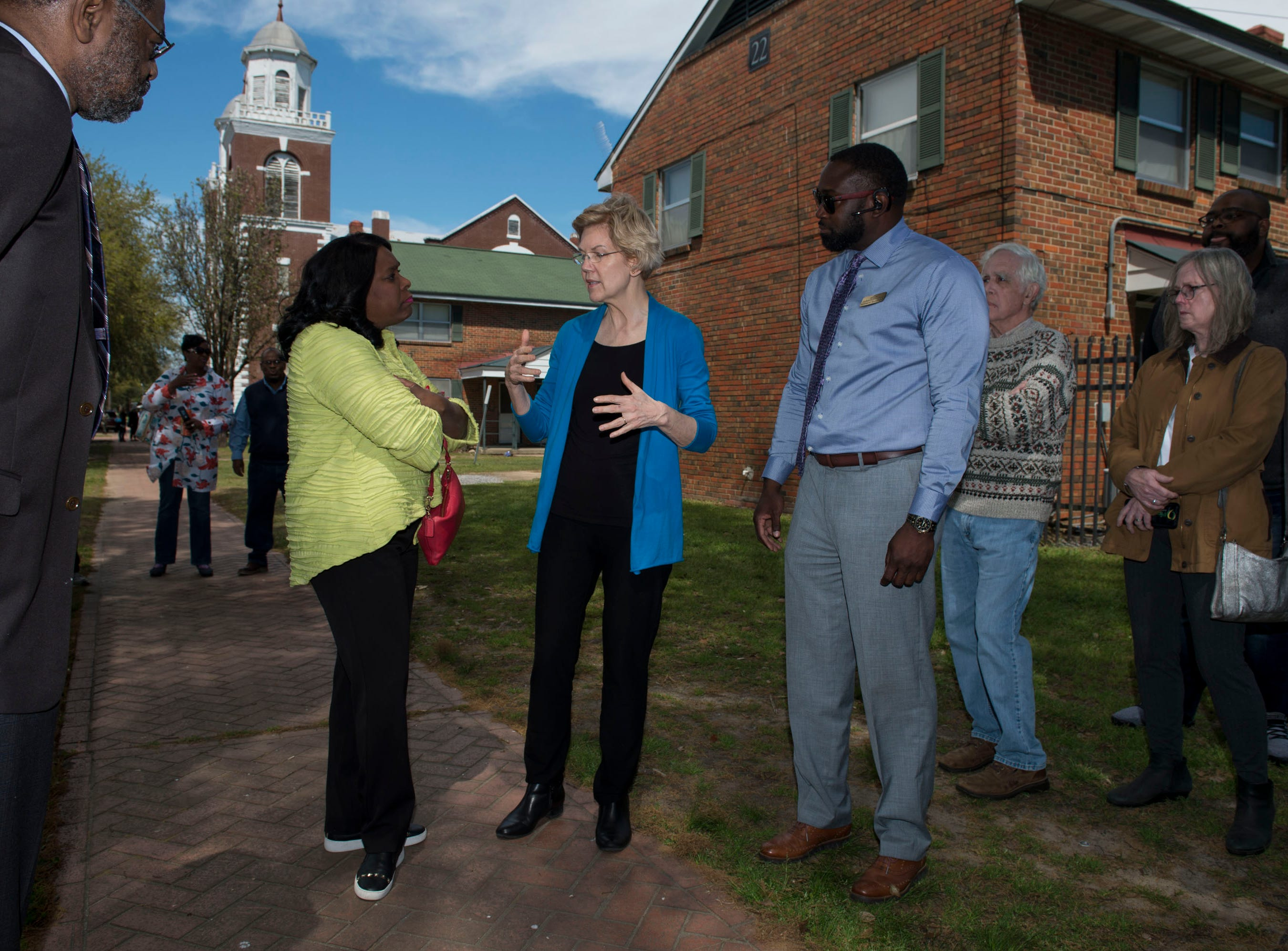Rep. Terri Sewell, left, and Sen. Elizabeth Warren talk outside  Brown Chapel AME Church in Selma, Ala., on Tuesday, March 19, 2019.