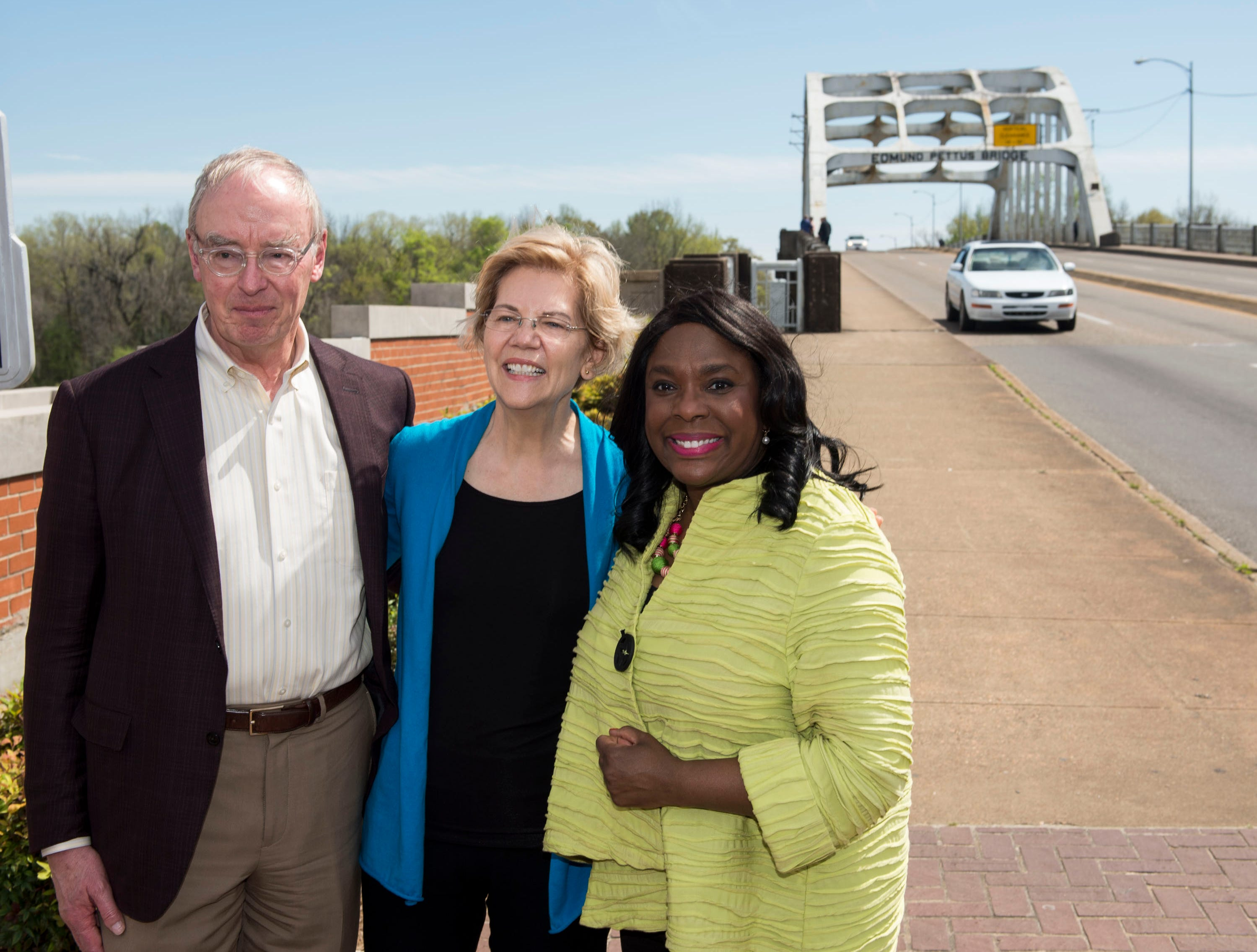 Sen. Elizabeth Warren poses with her husband, Bruce Mann, left, and Rep. Terri Sewell, left, in front of the Edmund Pettus Bridge at Brown Chapel AME Church in Selma, Ala., on Tuesday, March 19, 2019.