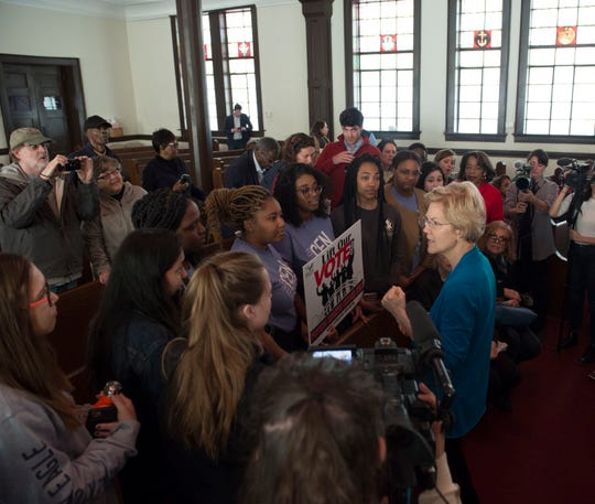 Sen. Elizabeth Warren talks with students from Florida State University at Brown Chapel AME Church in Selma, Ala., on Tuesday, March 19, 2019.