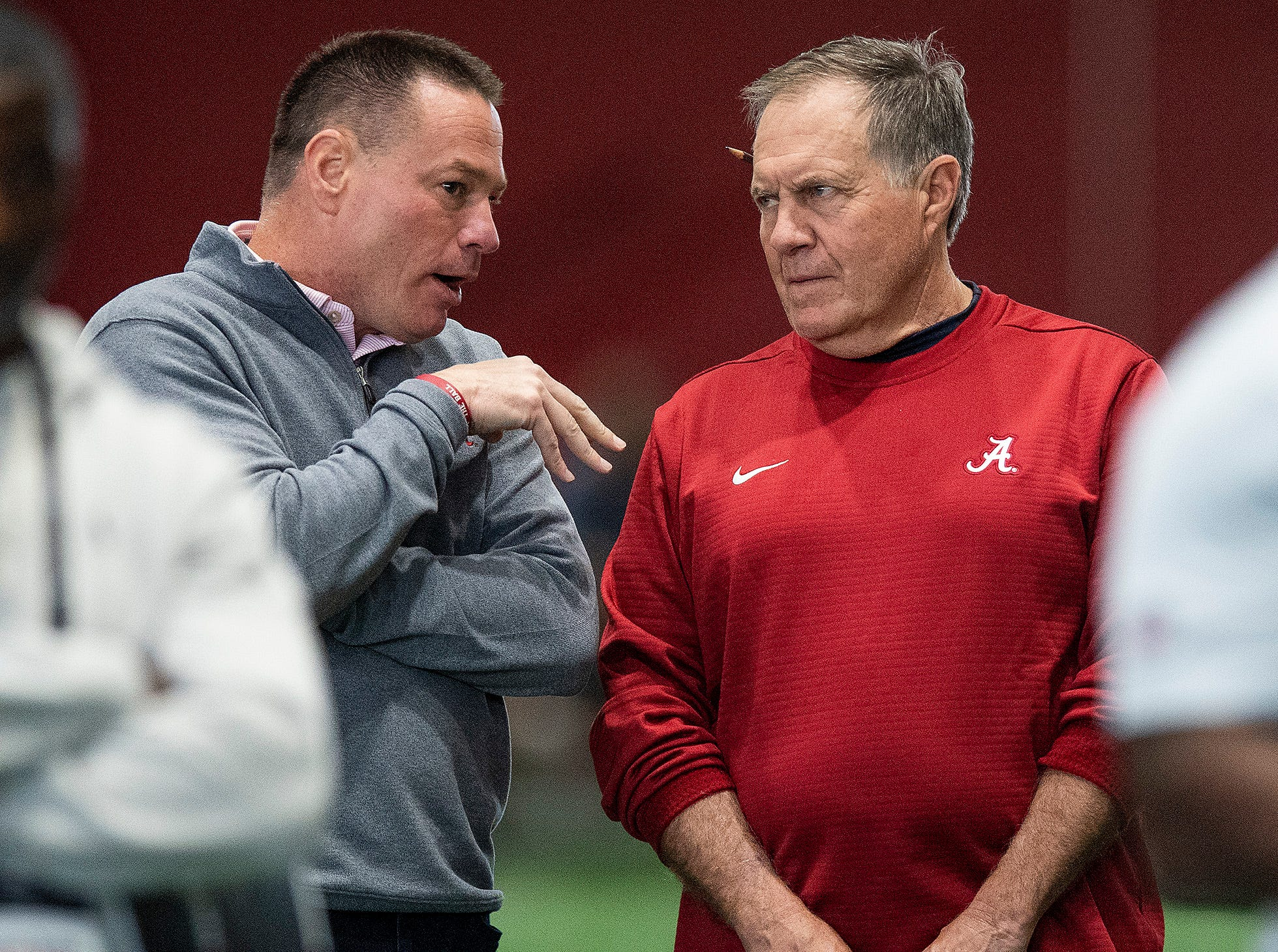 Alabama's Butch Jones, left, talks with New England Patriots coach Bill Belichick during Pro Day on the University of Alabama campus in Tuscaloosa, Ala., on Tuesday March 19, 2019.