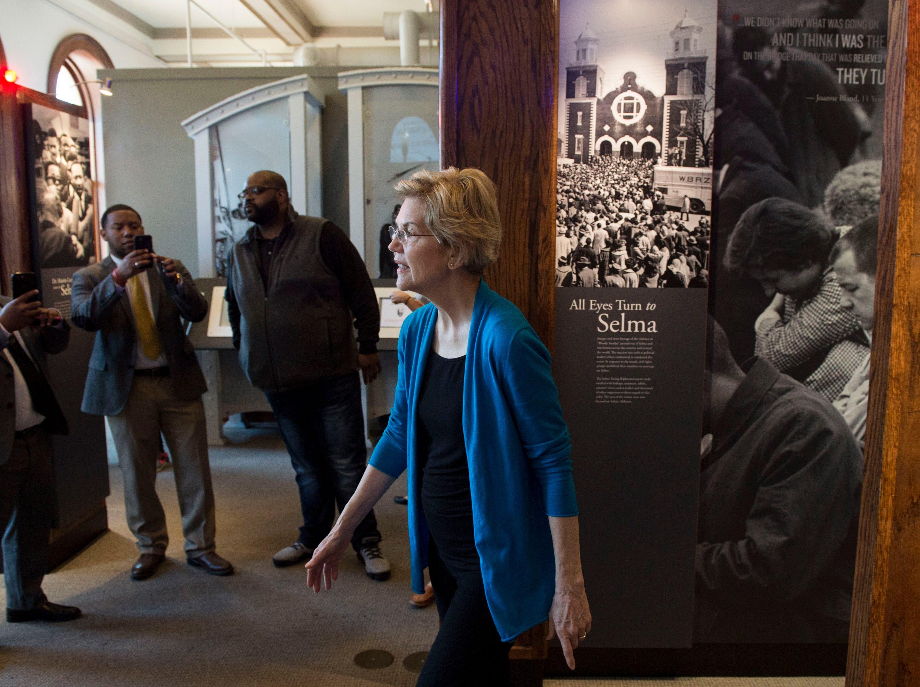 Sen. Elizabeth Warren looks through the exhibits at the Selma Interpretive Center in Selma, Ala., on Tuesday, March 19, 2019.