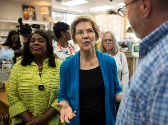 Sen. Elizabeth Warren, middle talks with owner Tim Williamson at Cater's Drug Store in Selma, Ala., on Tuesday, March 19, 2019.
