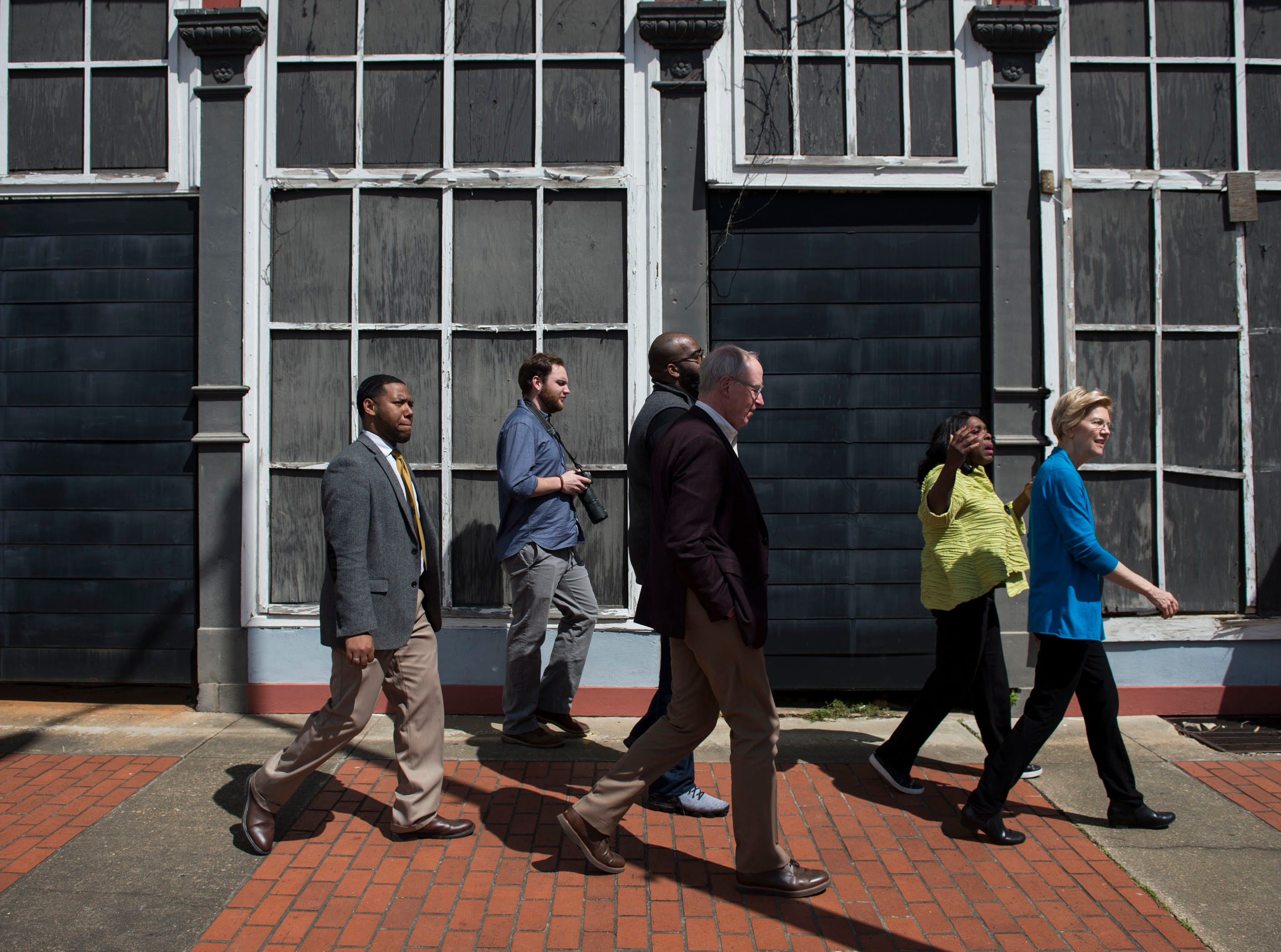Sen. Elizabeth Warren, right, and Rep. Terri Sewell walk the streets of downtown Selma, Ala., on Tuesday, March 19, 2019.